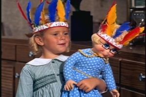 Random twin image: Buffy and Mrs. Beasley, who are playing cowboys and Indians with Jody.