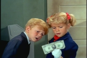 At this point, the twins find a $20 dollar bill. Bright children might realize that this money could help them get home. In this episode, however, Jody and Buffy (who has previously been shown doing multiplication) are so dim that it takes them a while to realize that a 2 and 0 together make 20.