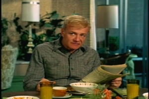 Reading the paper, Bill notices that the rodeo is in town and decides that will be the first of the week's activities. (That's some cute mid-century dinnerware on the table.)