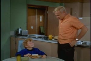 After school, a ravenous Jody wolfs down a decent sandwich and explains the day's events to Uncle Bill.