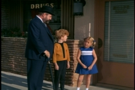 First they stop outside a drug store and remember going there for ice cream with their parents.