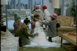 Seizing on a loophole, they haul snow inside and build their snowman in the living room.