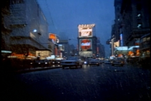 I like this rainy Times Square establishing shot.