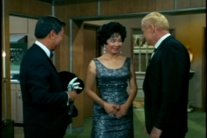 Mrs. Chang mentions that her father-in-law has been feeling ill, but Mr. Chang thinks company will do him good. (Again, I just love that gown.)