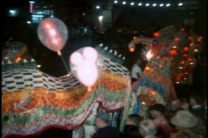 Enter the dragon. (Wait--are those Mickey Mouse balloons in this Chinese New Year stock footage? What the...?)