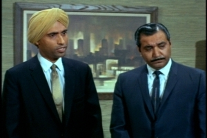 """His East Indian associates have an """"only in America"""" moment when they learn that doll hospitals exist."""