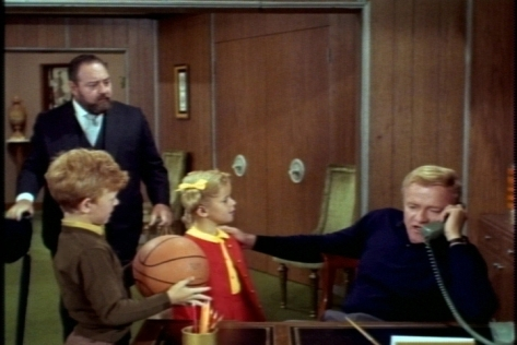 When the twins rush in, Jody is eager to show Bill his new regulation-sized basketball.