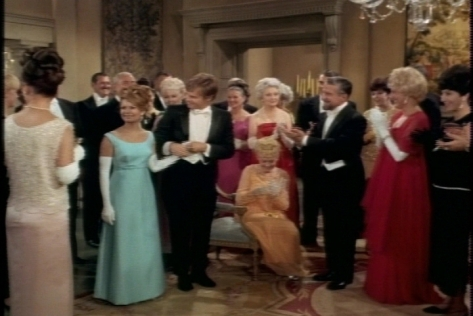 I do like Cissy's evening gown in this scene.