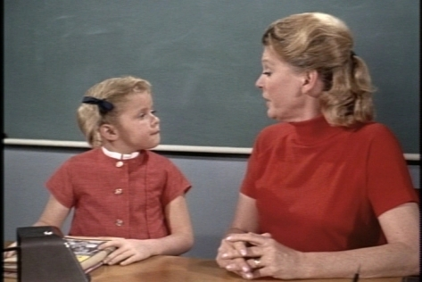 Later, Miss Cummings asks Buffy to stop by Eve's apartment after school to drop off a new textbook.