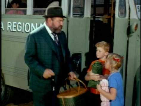 French tells the kids to get on the Sitges bus while he runs back to get the doll.