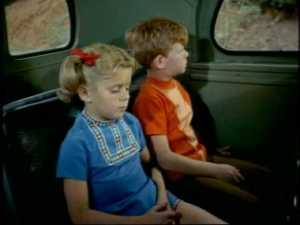 The dejected twins return to their seat.