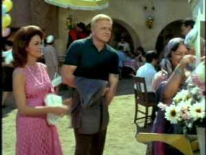 "Back in the marketplace, Bill is buying flowers for the ""senorita hermosa."""