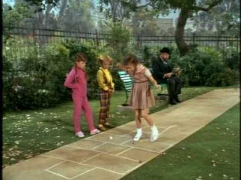 In the rigidly gender-segregated world of the park, Buffy has to play hopscotch instead.