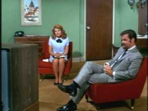 Because Cissy and this guy with a beard are sitting in a Family-Affair-green office and watching him.