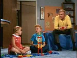 Back at home, the twins are building a block tower, and Buffy's predicting that it will fall if it get's any taller.