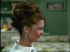 Bill gives Cissy a pair of sparkly clip-on earrings.