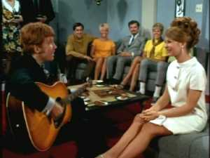 As the party guests bob their heads and tap their feet, he launches into the ballad he wrote just for her.