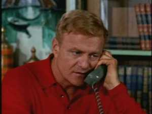 He calls his office and orders Miss Grayson to track down Charlie or his manager in Boston.